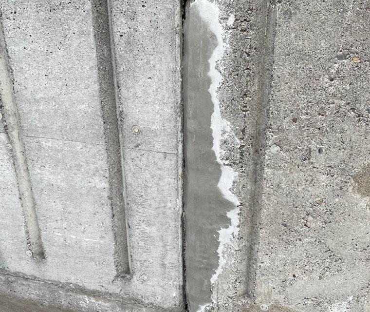 ひび割れした擁壁、側面部分の補修完了写真